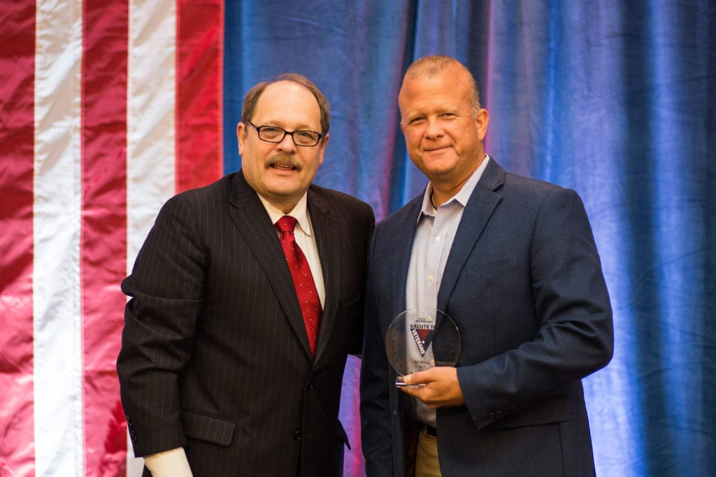 Kristopher Wissing accepted his award from Louisville Business First market president and publisher Gary Tyler.